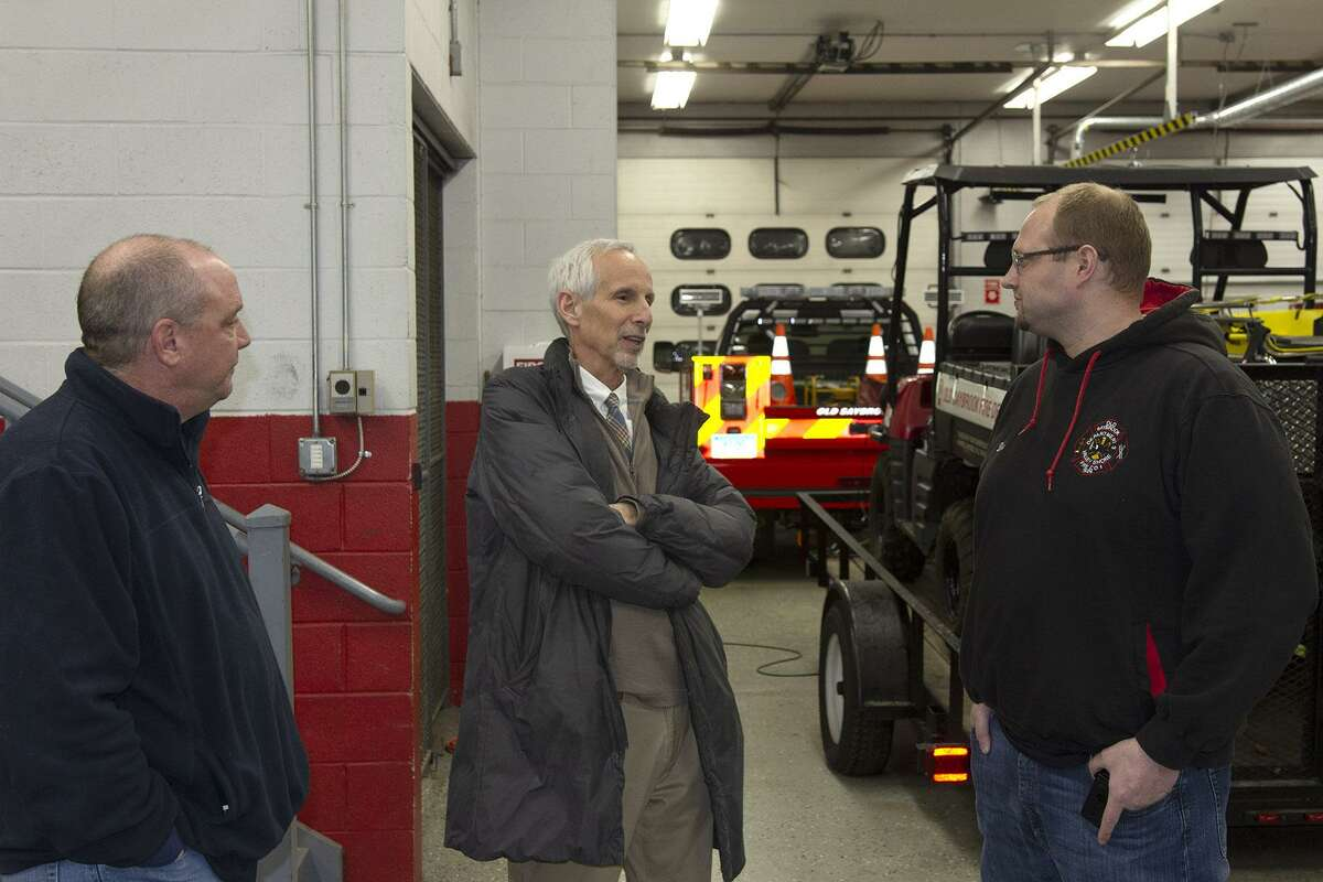 State Sen. Norm Needleman, center, speaks with Old Saybrook Fire Department Lt. Bill Decapua, left, and First Assistant Chief James Dion during a visit and tour of the fire department.