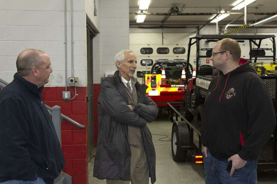 State Sen. Norm Needleman, center, speaks with Old Saybrook Fire Department Lt. Bill Decapua, left, and First Assistant Chief James Dion during a visit and tour of the fire department. Photo: Contributed Photo