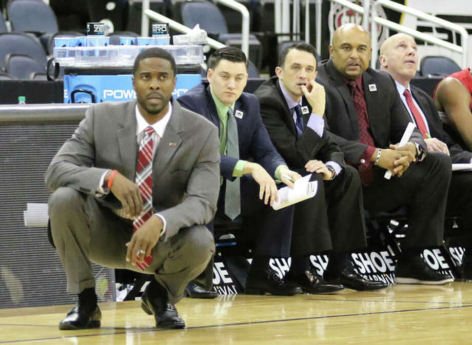 SIUE coach Jon Harris (left) watches his Cougars during Wednesday's game against Morehead State in the Ohio Valley Conference Tournament at Ford Center in Evansville. That would be Harris' final game at SIUE, which announced Monday' that his contract would not be renewed. Photo: Greg Shashack / The Telegraph