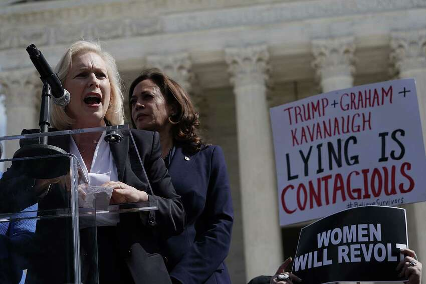 WASHINGTON, DC - SEPTEMBER 28: U.S. Sen. Kirsten Gillibrand (D-NY) (L) speaks as Sen. Kamala Harris (D-CA) (R) listens during a rally in front of the U.S. Supreme Court September 28, 2018 in Washington, DC. Activists staged a rally to call to drop the nomination of Judge Brett Kavanaugh to the U.S. Supreme Court.