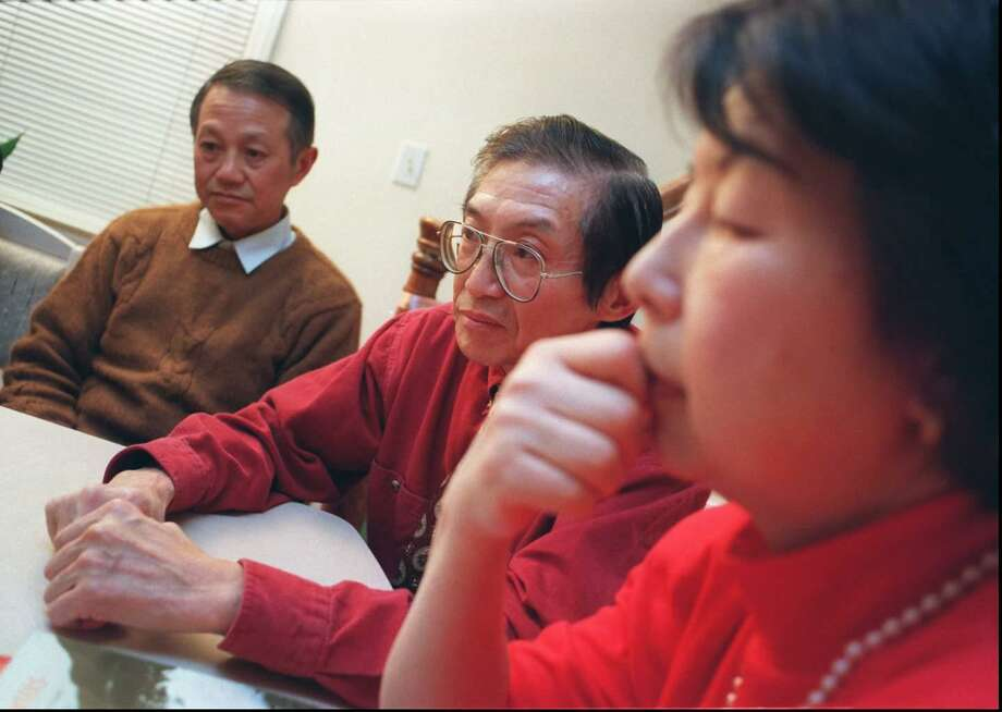 Anthony Ho, left, is trying to get religious asylum in the United States from China with the help of his family, Stamford residents Dr. Joseph Ho, center, and Catherine Ho, the doctor's wife. The three escaped from labor camps in China where they were imprisoned for refusing to renounce their Catholic beliefs. Andrew Sullivan / Advocate Photo Photo: ST