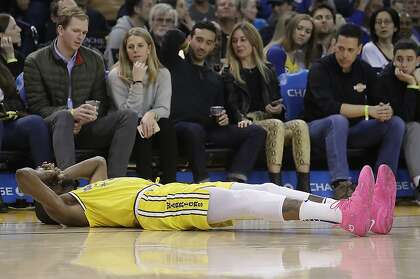 1a5cc581270 Golden State Warriors forward Kevin Durant reacts after injuring his ankle  during the second half of an NBA basketball game against the Phoenix Suns  in ...