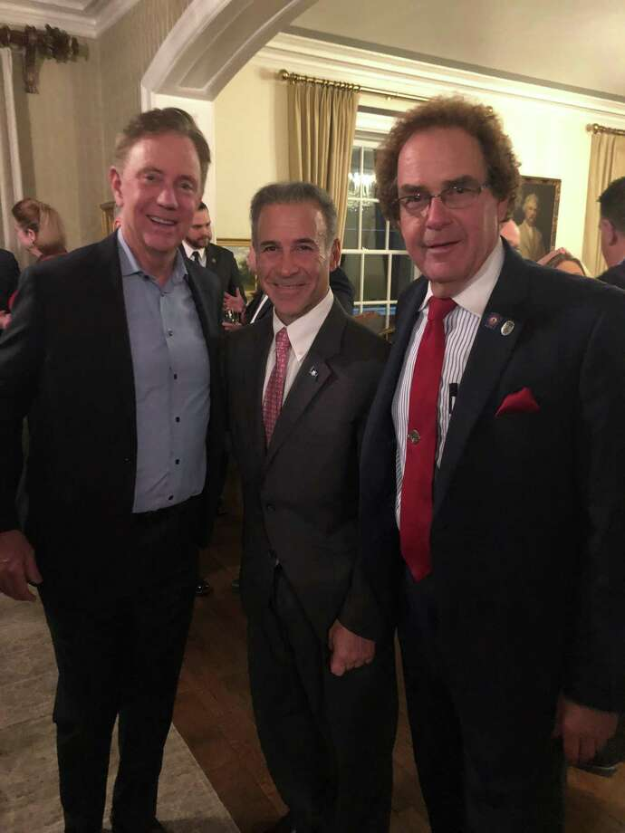 """Gov. Ned Lamont, left, state Rep. Fred Camillo, R-Greenwich, and state Rep. Tom Delinicki, R-South Windsor, posed at the Valentine's Day """"meet and greet"""" cocktail party for Republican legislators at the governor's residence in Hartford on Thursday, Feb. 14. Photo: Contributed"""