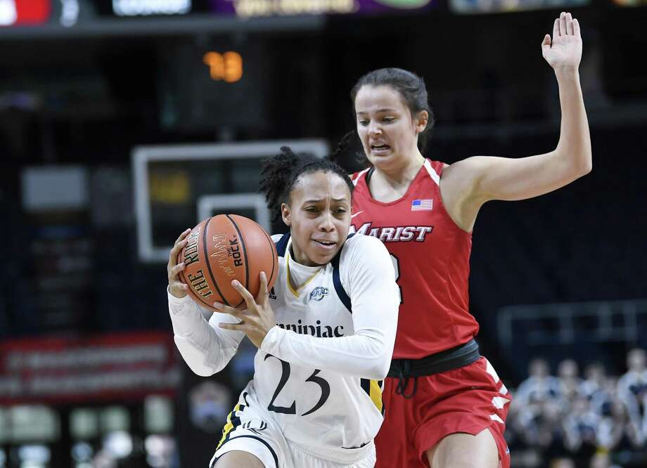 Quinnipiac's Brittany Martin (23) moves the ball past Marist's Allie Best during the first half of the MAAC championship game on Monday. Photo: Hans Pennink / Associated Press / Copyright 2019 The Associated Press. All rights reserved.