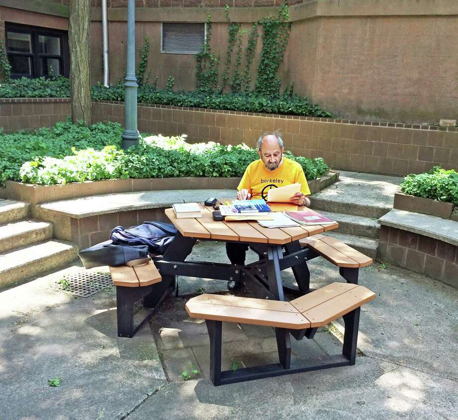 Longtime Middletown resident Roy Lisker, who died Feb. 28, is shown studying in the courtyard of the Russell Library in Middletown in July 2015. Photo: Rolande Duprey Photo