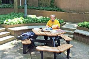 Longtime Middletown resident Roy Lisker, who died Feb. 28, is shown studying in the courtyard of the Russell Library in Middletown in July 2015.