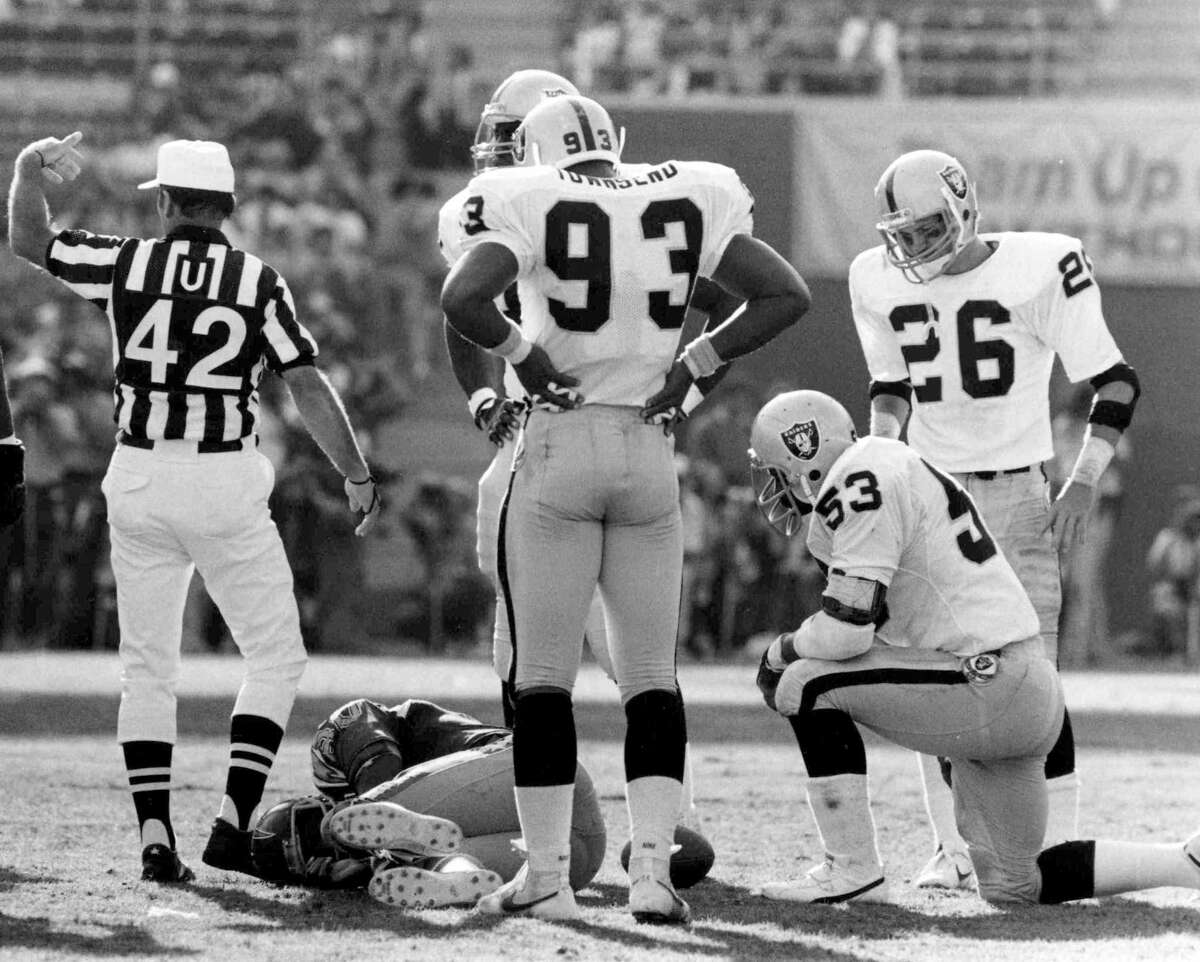 San Diego Chargers Hall of Fame tight end Kellen Winslow lies in pain on the field after suffering a knee injury during a 44 to 37 loss to the Oakland Raiderson October 21, 1984 at Jack Murphy Stadium in San Diego, California. (Photo by Miguel A. Elliot/Getty Images)