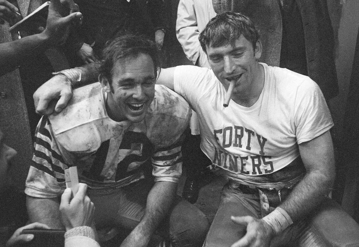 San Francisco 49ers quarterback John Brodie, left, and linebacker Dave Wilcox had happy answers during interview following 38-7 win over the Oakland Raiders at the rain-soaked Coliseum, Dec. 20, 1970. The victory gave the 49ers the Western Division championship of the NFL, their first ever since joining the league in 1950. (AP Photo)