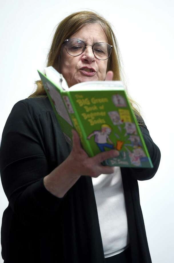 "Judge Julia Dewey reads ""Wacky Wednesday"" by Dr. Seuss to special needs students at High Road School in Wallingford Wednesday. Photo: Arnold Gold / Hearst Connecticut Media / New Haven Register"