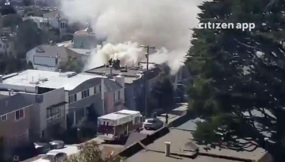 Screen captures of video from the SF Citizen app show a fire burning in San Francisco's Westwood Highlands neighborhood on March 11, 2019. Photo: SF Citizen / Screen Capture