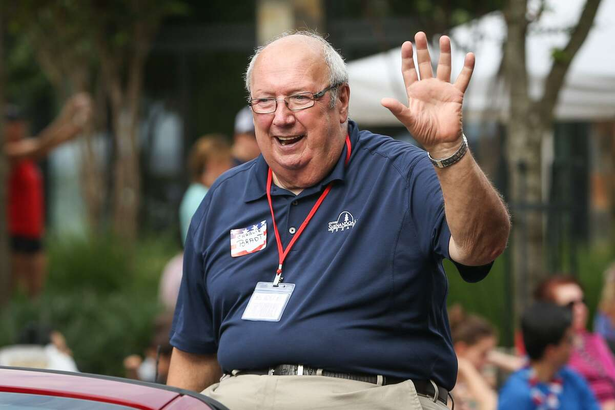 Shenandoah City Councilman Charlie Bradt waves to attendees of the South County Fourth of July Parade on Tuesday at Market Street in The Woodlands. Bradt secured another term in office in the May 4 election, running unopposed.