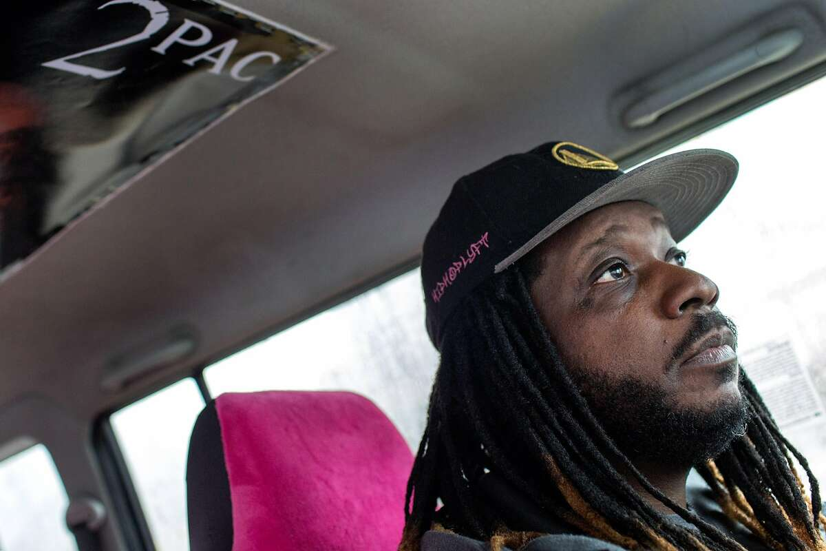 """Deco Carter is one of the first Lyft drivers who established a persona as """"Hip Hop Lyft."""" He does trivia games with some passengers and gives prizes. Despite his early start, Carter falls shy of the 10,000 rides that would win him a $1000 bonus from Lyft and a chance to buy its stock at opening-day price because he only drives part time now. Saturday, March 9, 2019. San Francisco, Calif."""