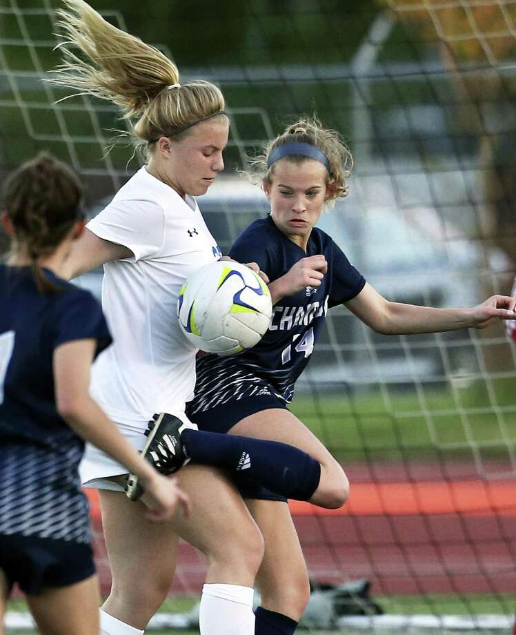 Champion's Mary Claire Stoelzing, right, had four goals and four assists in wins last week. Photo: Tom Reel / Staff Photographer / 2017 SAN ANTONIO EXPRESS-NEWS