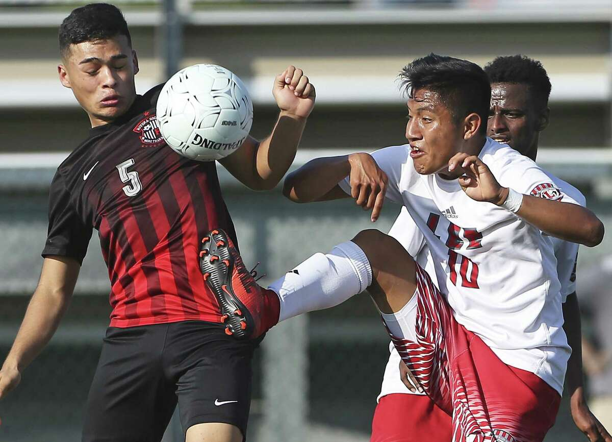 Wilmar Aguilar (10) battles against Alberto Garcia for control as Lee plays Brownsville Rivera in Region IV-6A soccer playoffs at Blossom Soccer Stadium on April 13, 2018.