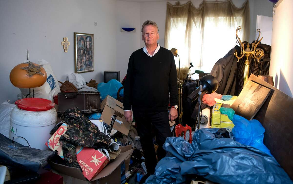 Head of the compulsive hoarding academy, Michael Schroter, stands in the room of a hoarder, which has been rebuilt for training and visualisation purposesm in the compulsive hoarding academy in Gauting, Germany, 11 October 2016. The foundation ceremony of the academy, where people will be trained to help compulsive hoarders in the future, takes place on 14 October. PHOTO: SVEN HOPPE/dpa | usage worldwide (Photo by Sven Hoppe/picture alliance via Getty Images)