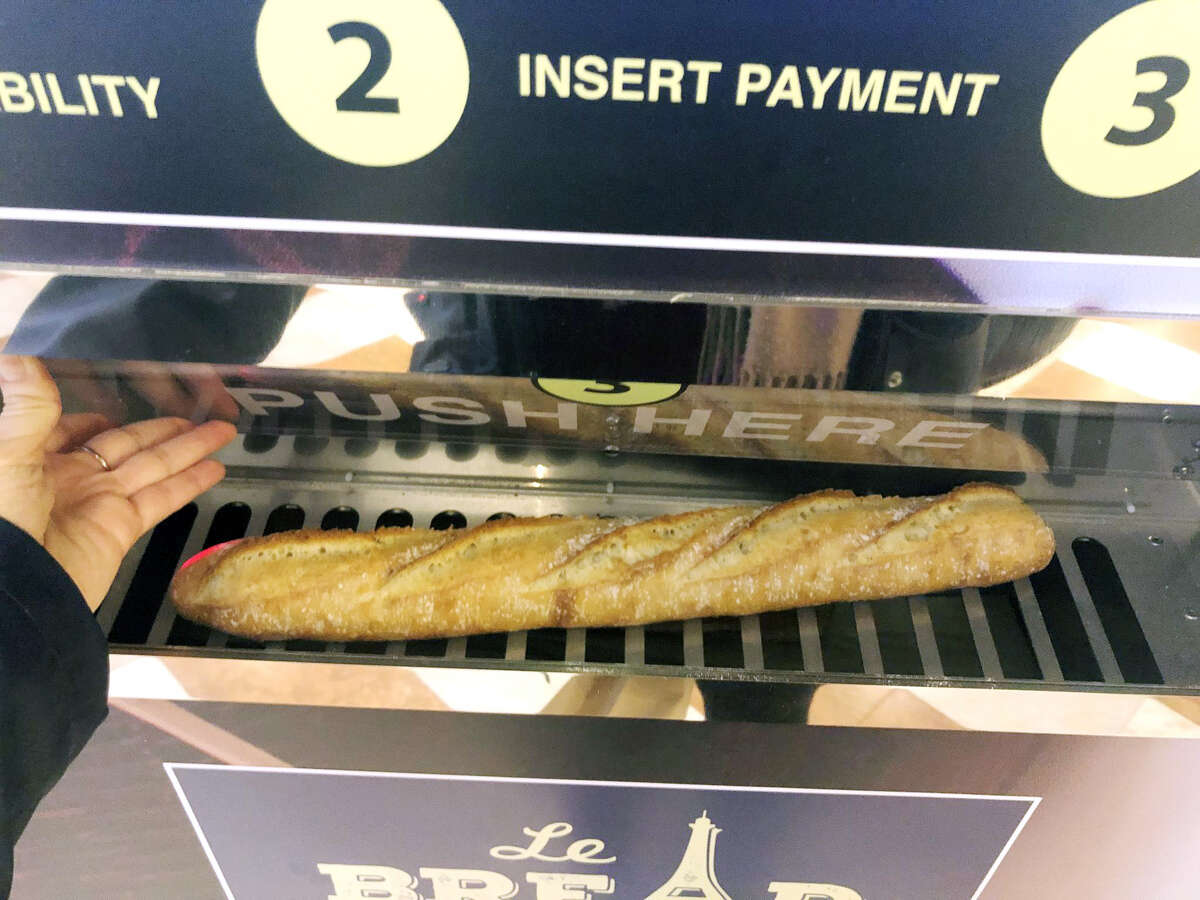 After you swipe your card or enter cash, the machine dispenses a warm baguette in about 20 seconds.