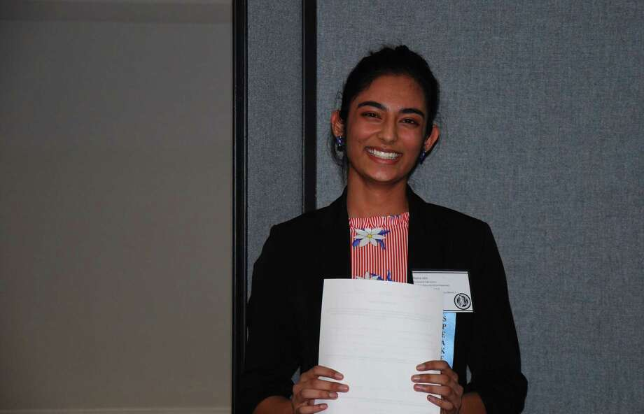 Raina Jain won first place of 12 students who gave Ted Talk-style presentations of their science projects over the weekend at the Connecticut Junior Science and Humanities Symposium. She will compete at the national symposium this April in Albuquerque with her project, which discovered a way to protect honey bees from a mite known to be killing off thousands of hives across the country. Photo: Contributed