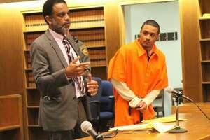 Senior Assistant Public Defender Scott M. Jones with defendant Marcus Rivera in court in March.