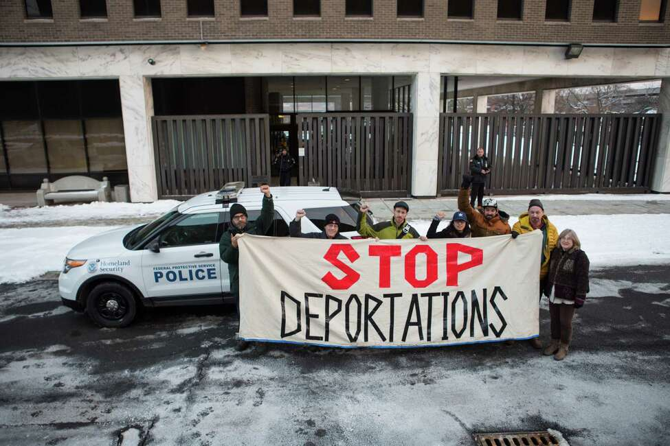 Protesters from various pro-immigration groups in Columbia County staged a sit-in at New York Congressman John Faso's Kinderhook office on Dec. 18, 2017, urging him to support a Clean DREAM Act. (Photo courtesy of Bryan MacCormack)