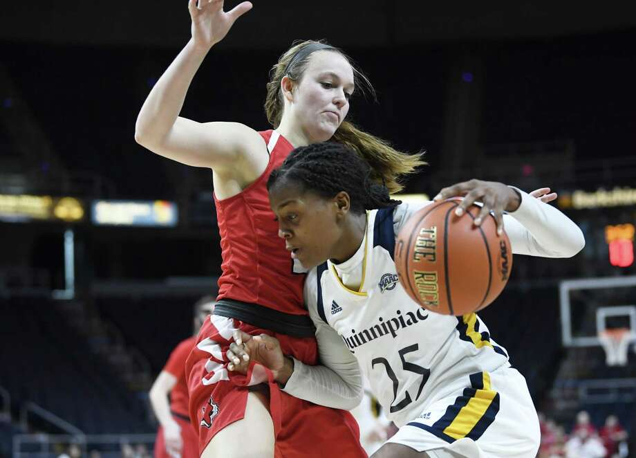 Quinnipiac guard Aryn McClure (25) moves the ball in front of Marist guard Rebekah Hand (23) during the MAAC Tournament championship March 11. Photo: Hans Pennink / Associated Press / Copyright 2019 The Associated Press. All rights reserved.