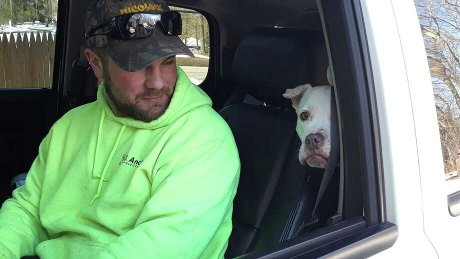 Joe Tralongo, a new customer who recently adopted Haylee, a dog from the West Haven animal shelter, was sitting in his truck outside the animal clinic Monday afternoon. He had a scheduled appointment and was surprised to learn the clinic was closed. Photo: Emily M. Olson / Hearst Connecticut Media /