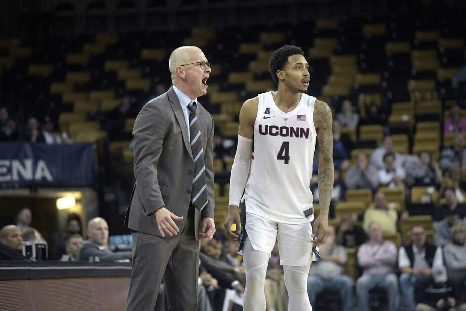 Connecticut head coach Dan Hurley, left, calls out with guard Jalen Adams (4) during the second half of an NCAA basketball game against Central Florida Thursday, Jan. 31, 2019, in Orlando, Fla. UCF won 73-67. (AP Photo/Phelan M. Ebenhack) Photo: Phelan M. Ebenhack / Associated Press / Copyright 2019 The Associated Press. All rights reserved
