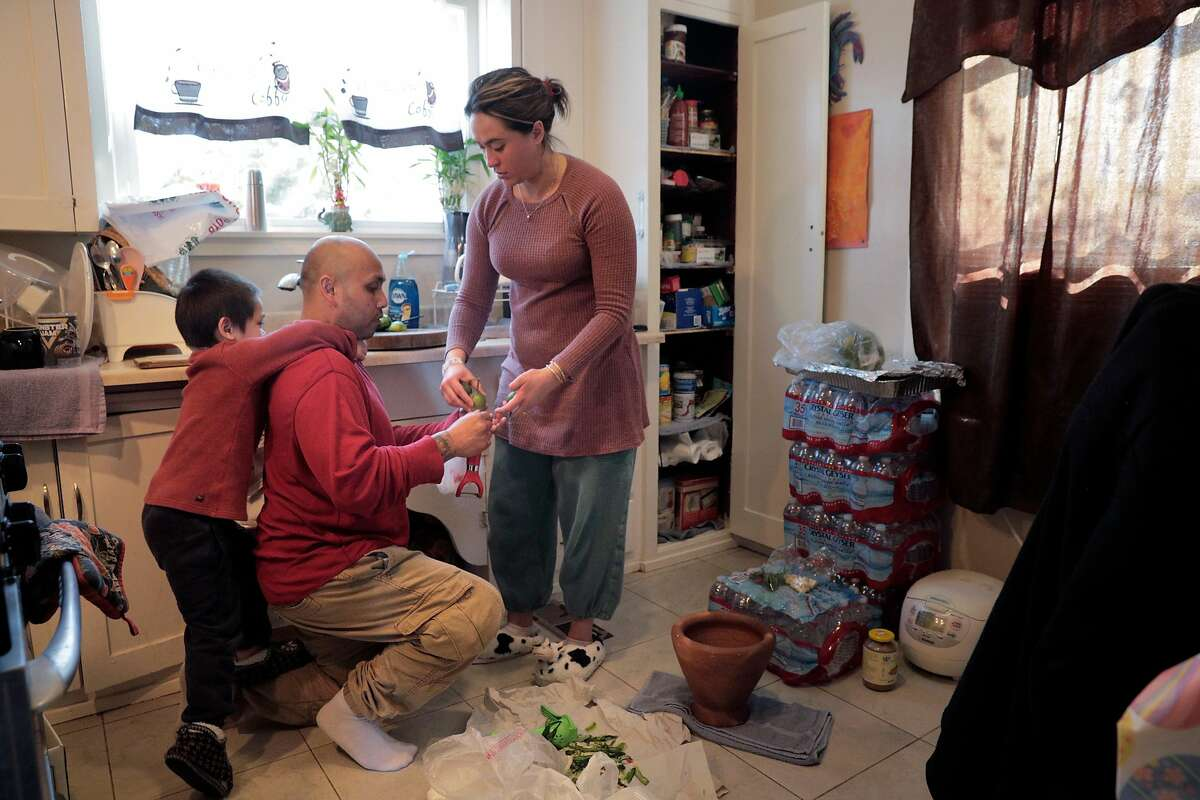 Hay Hov and his wife, Catherine Depooter-Hov prepare dinner with their son, Robbie, 4, in the kitchen in their home in Oakland, Calif., on Monday, March 11, 2019. Hov is at risk of deportation because of a crime committed 19 years ago when he was a 19, and he now faces deportation to a country he doesn't recognized after being brought here at the age of 6 by his parents.