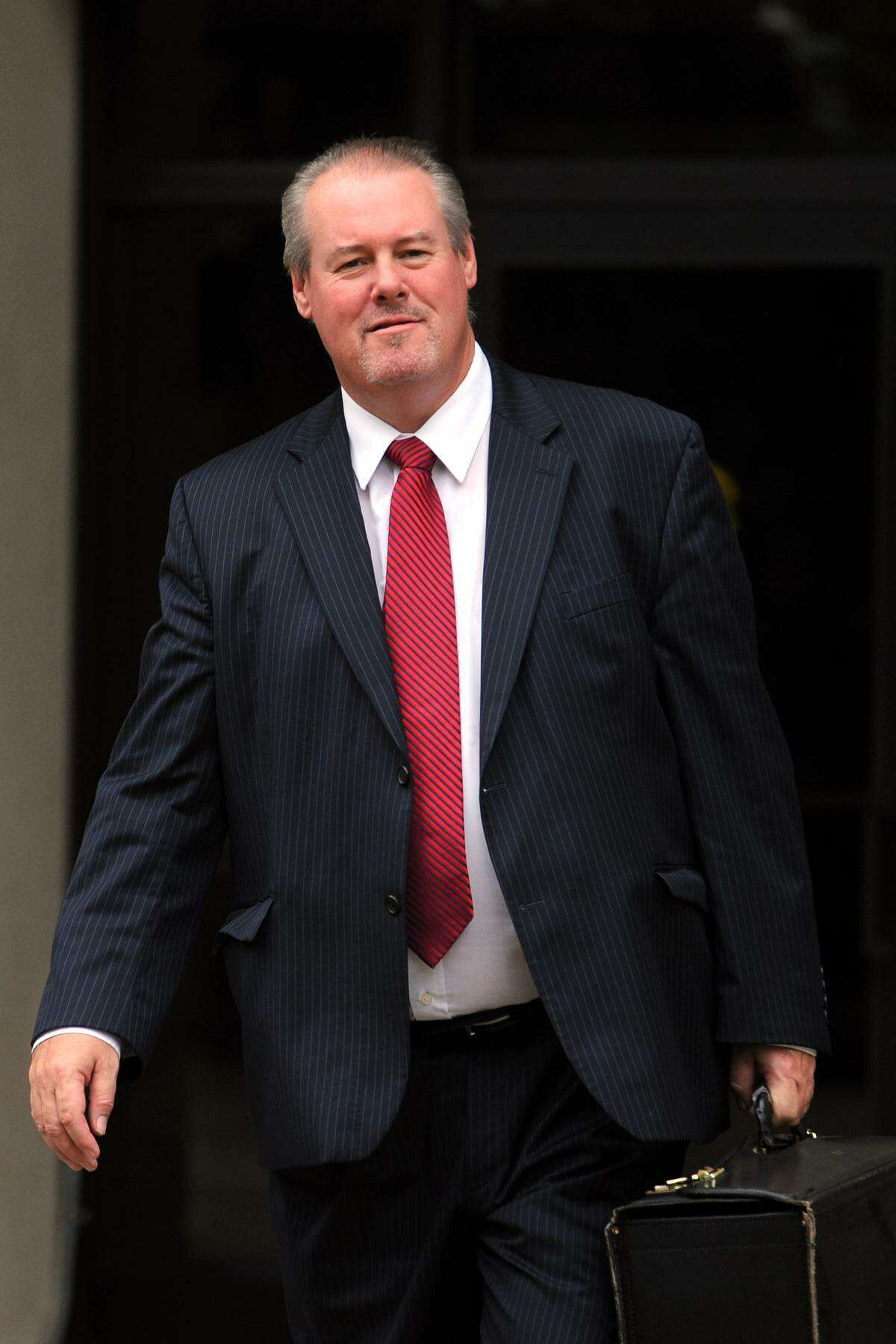 Attorney Edward Gavin leaves the Federal Courthouse, in Bridgeport, Conn., Aug. 22, 2013.
