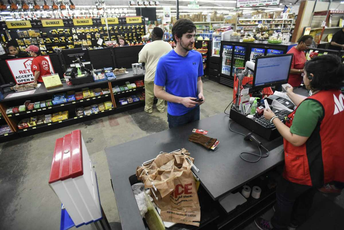 James Bothwell checks out after shopping at M&D Supply - Ace Hardware in Beaumont on Monday. Photo taken on Monday, 03/11/19. Ryan Welch/The Enterprise