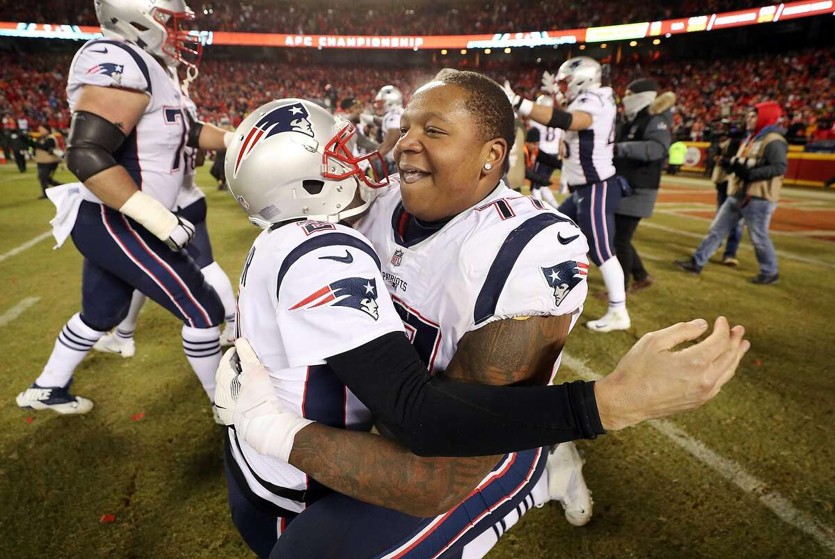 KANSAS CITY, MISSOURI - JANUARY 20: Brian Hoyer #2 and Trent Brown #77 of the New England Patriots celebrate after defeating the Kansas City Chiefs during the AFC Championship Game at Arrowhead Stadium on January 20, 2019 in Kansas City, Missouri. The New