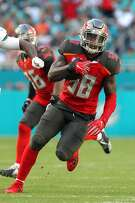 TAMPA, FL - NOV 19: Kwon Alexander (58) of the Bucs makes an interception and then runs the ball upfield during game between the Tampa Bay Buccaneers and the Miami Dolphins on Sunday, Nov. 19, 2017 at Hard Rock Stadium in Miami Gardens, Florida. (Photo by Cliff Welch/Icon Sportswire via Getty Images)