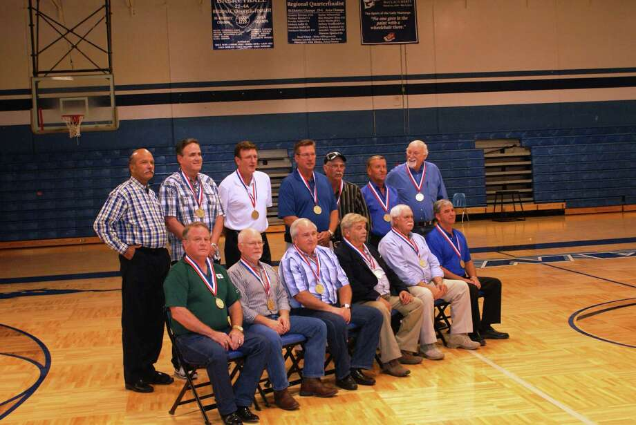 Friendswood's 1969 Class A state basketball champions gathered in 2011 as inductees into the Friendswood High School Sports Hall of Honor. Coach Walter Wilson, back row on the left, was joined by team members. Those inducted Wilson, Kent Ballard, Byron Cline, Perry Davis, Bill Holbrook, Arthur Kahn, Kevin Kelledy, Tom Long, Don Reed, Harley Robinson, Richard Stapp (posthumously), Wyatt Tompkins, Kenneth Toon, Rodney Unruh, and Mike Worden. Other coaches were Danny Pollard and Don Hamilton. Photo: SUBMITTED PHOTO / Submitted Photo