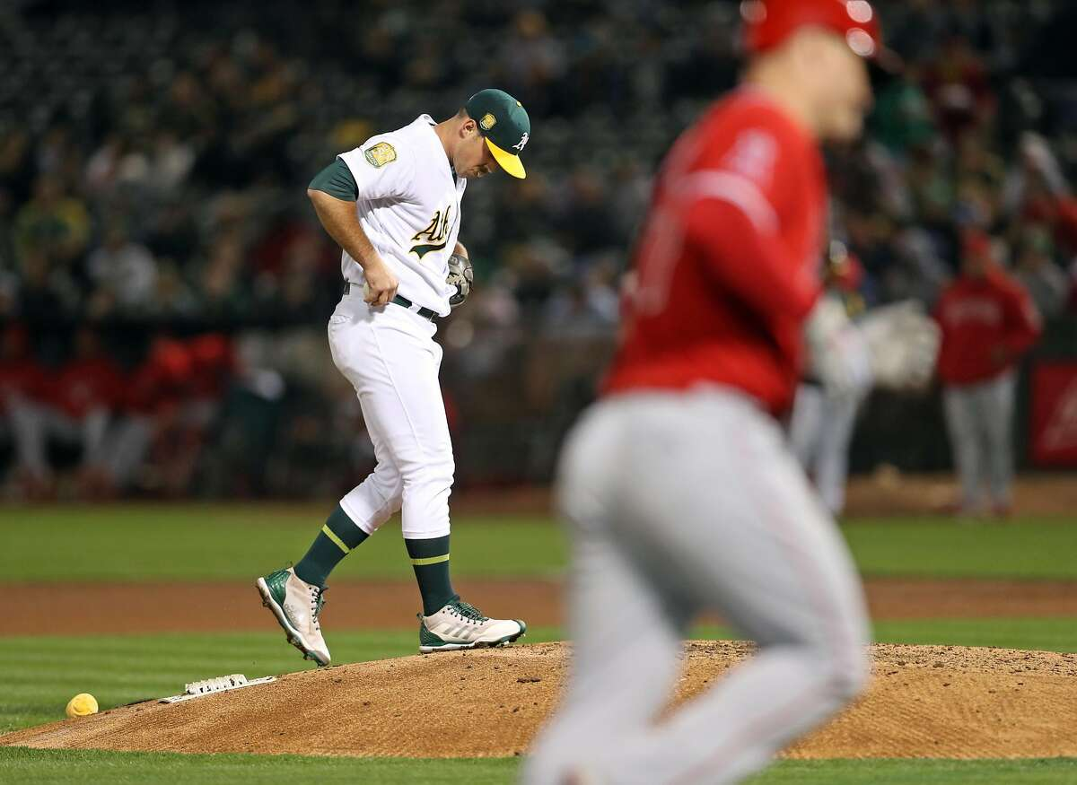 Oakland Athletics' Daniel Mengden reacts to giving up a solo home run to Los Angeles Angels' Mike Trout in 4th inning during MLB game at Oakland Coliseum in Oakland, Calif. on Tuesday, September 18, 2018.