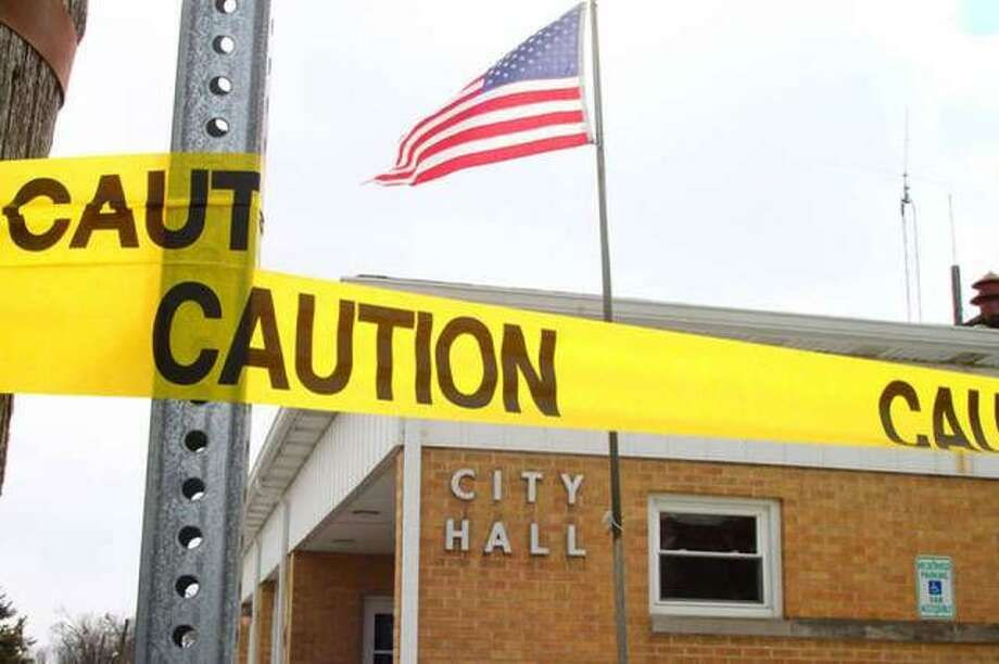 Caution tape blocks access to Winchester City Hall on March 5 as Illinois State Police investigated the stabbing of a man in downtown Winchester. Photo: Rosalind Essig | Journal-Courier