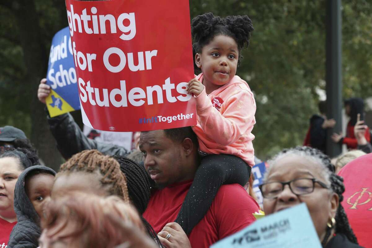 A girl in the crowd March 11 urges the Texas Legislature to act on public school funding. It did, but what will happen beyond 2021 remains an issue.