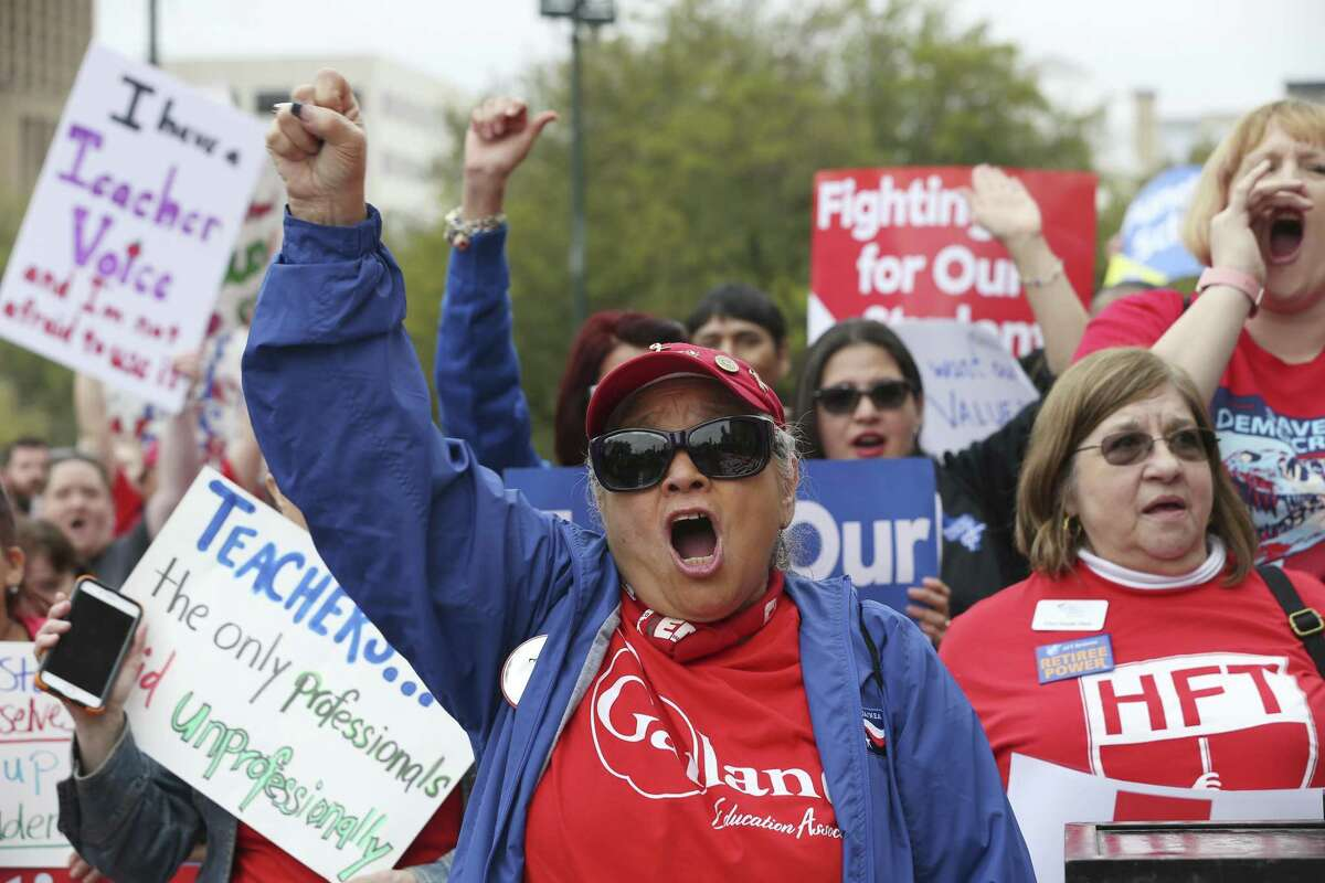 Koni Kaiwi, paraprofessional with the Garland Independent School District, joins in a chant during a rally at the State Capitol in Austin, Texas, Monday, March 11, 2019. A large crowd gathered at the capitol to urge the Texas Legislature for public school funding.