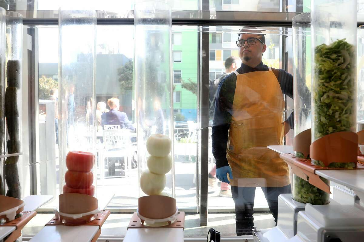 Tech Jeremy Flores checks the ingredients in Robot B at Creator on Folsom Street in S.F.