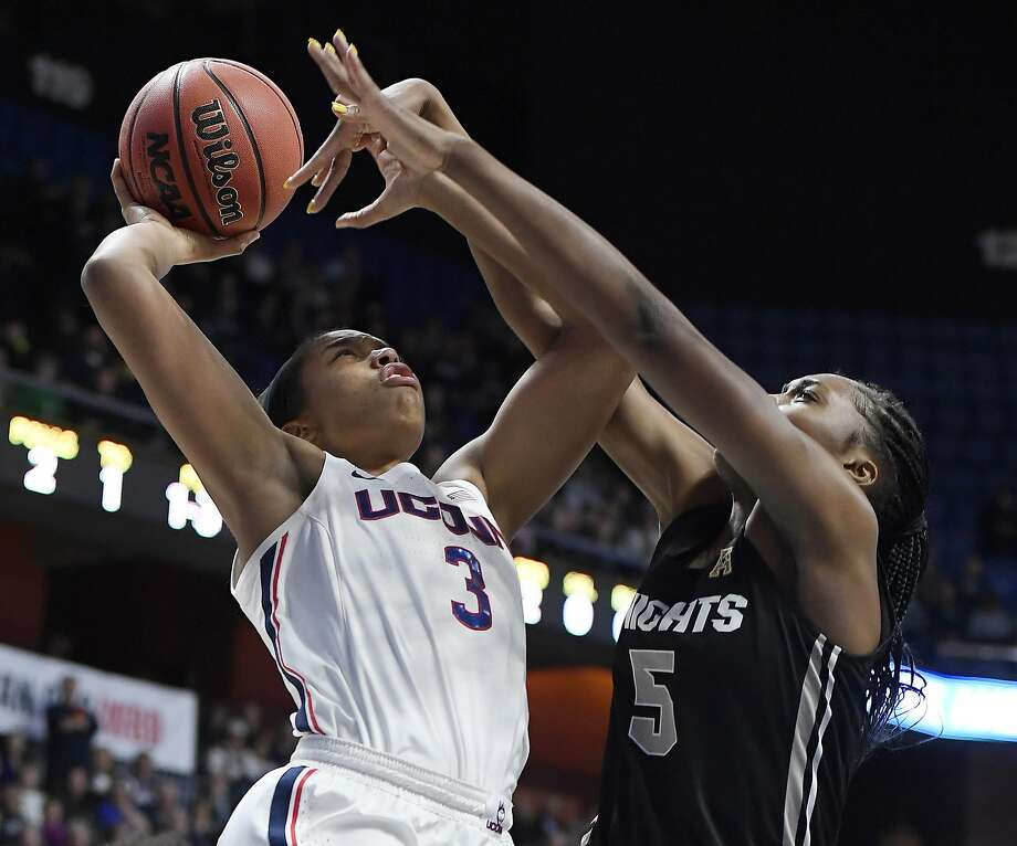 Central Florida's Masseny Kaba (5) fouls Connecticut's Megan Walker (3) during the first half of an NCAA college basketball game in the American Athletic Conference women's tournament finals, Monday, March 11, 2019, at Mohegan Sun Arena in Uncasville, Conn. (AP Photo/Jessica Hill) Photo: Jessica Hill, Associated Press