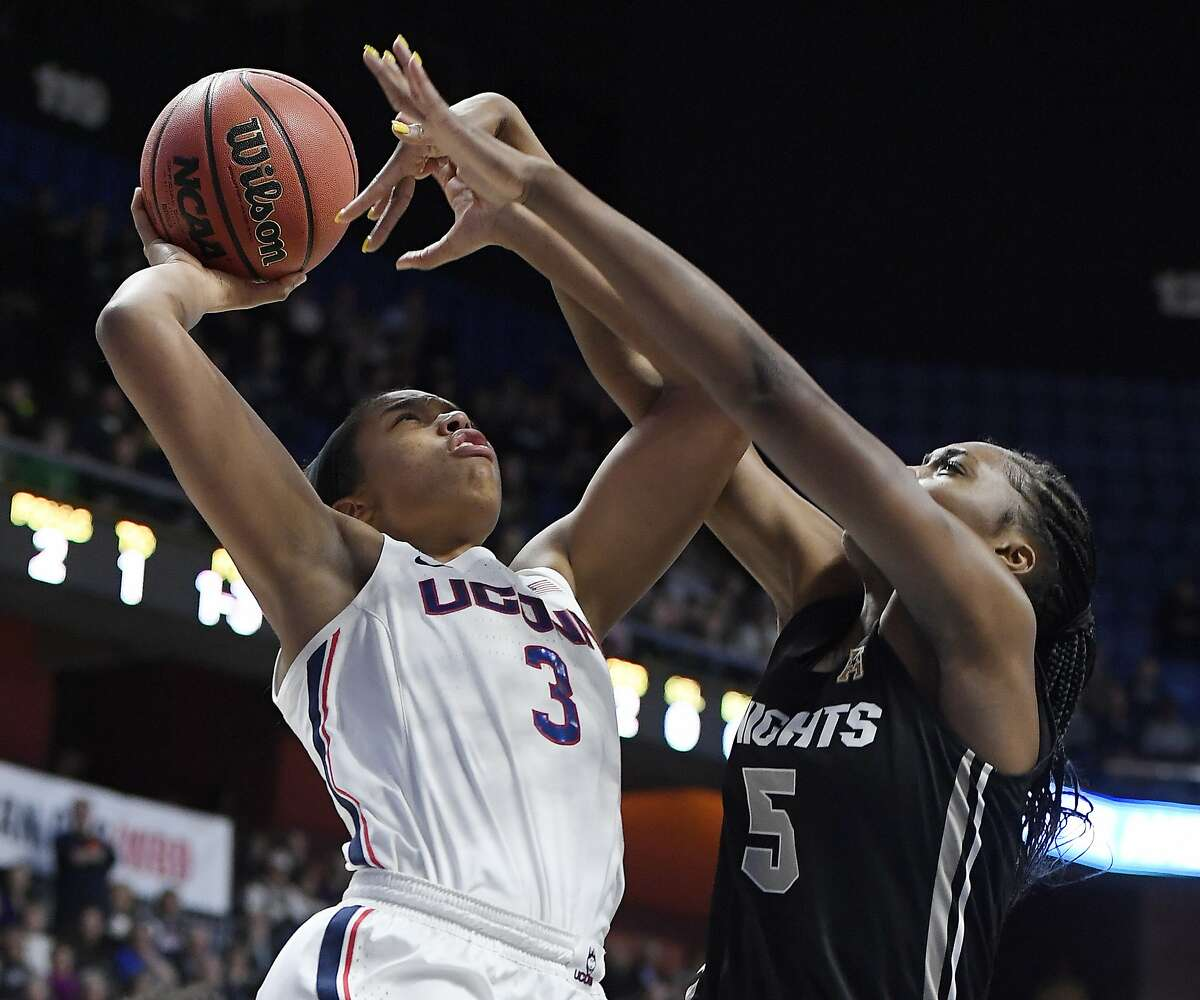 Central Florida's Masseny Kaba (5) fouls Connecticut's Megan Walker (3) during the first half of an NCAA college basketball game in the American Athletic Conference women's tournament finals, Monday, March 11, 2019, at Mohegan Sun Arena in Uncasville, Conn. (AP Photo/Jessica Hill)