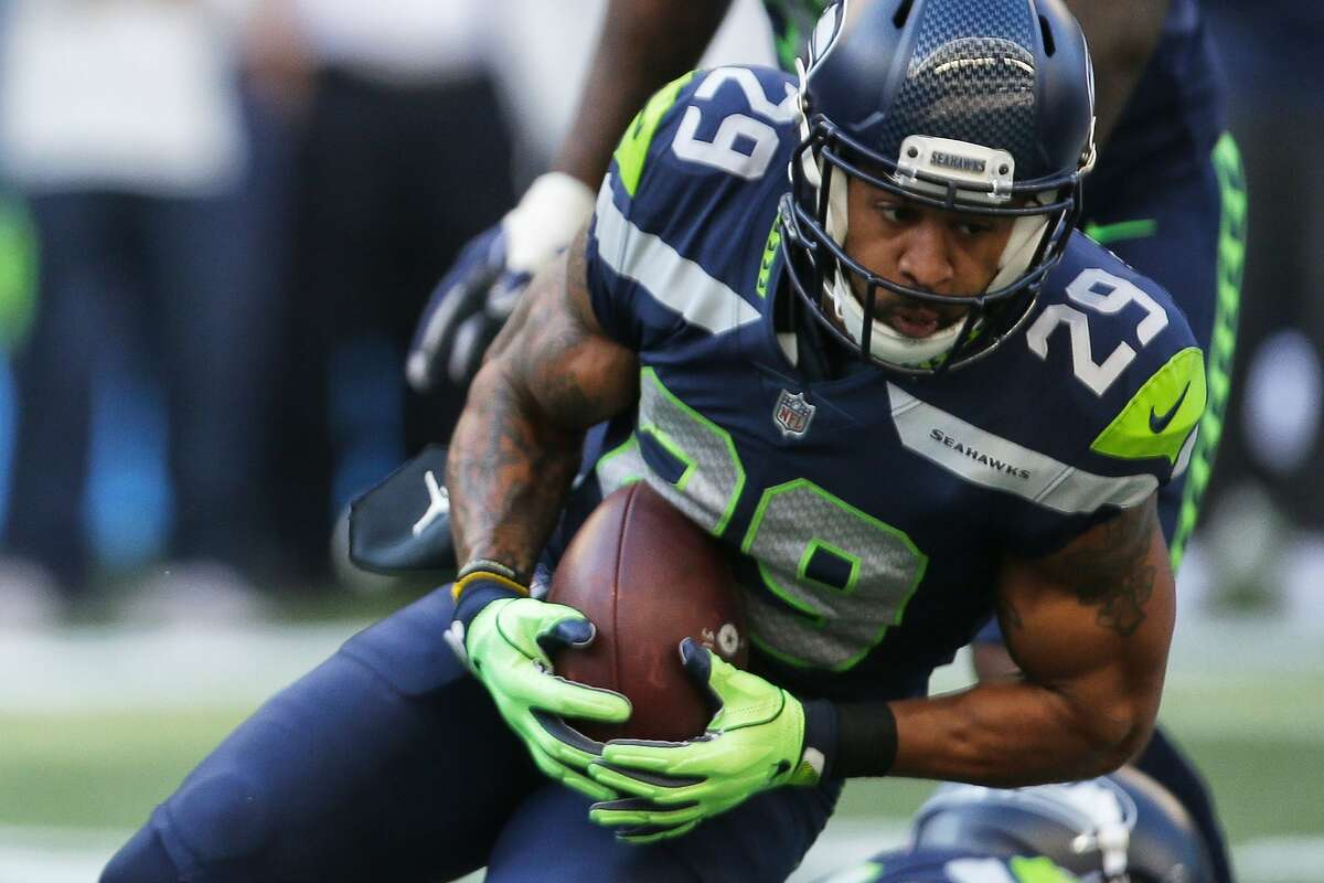Seahawks safety Earl Thomas makes an interception in the fourth quarter of Seattle's game against Dallas, Sunday, Sept. 23, 2018. (Genna Martin, seattlepi.com)