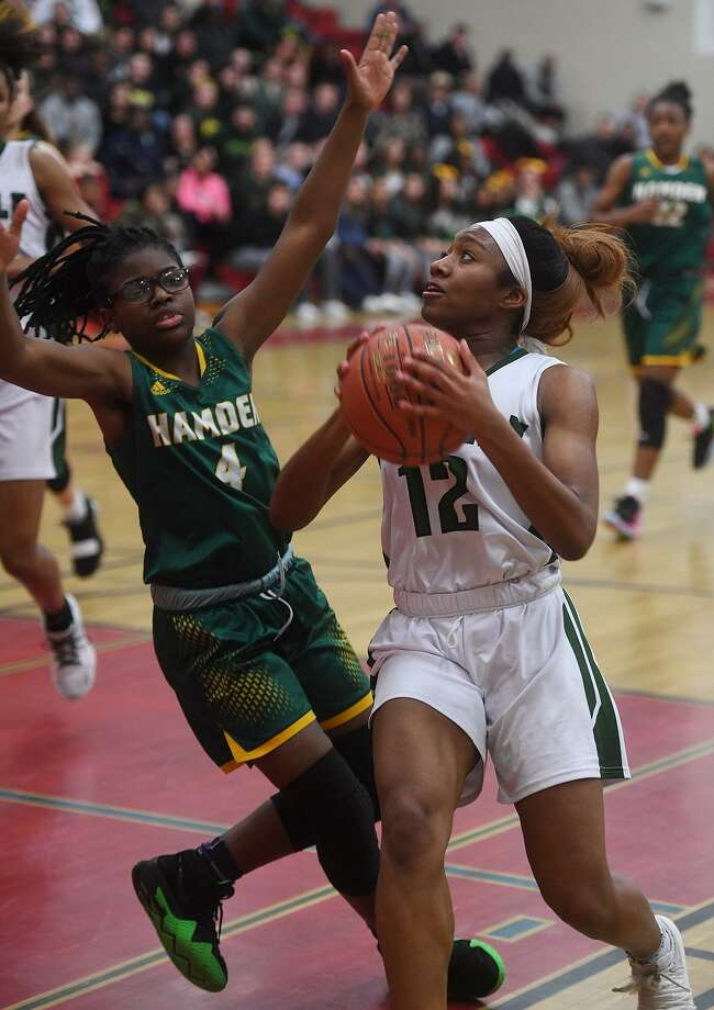 Norwalk's Sanaa Boyd drives to the basket against Hamden defender Diamond White on Monday. Photo: Brian A. Pounds / Hearst Connecticut Media / Connecticut Post