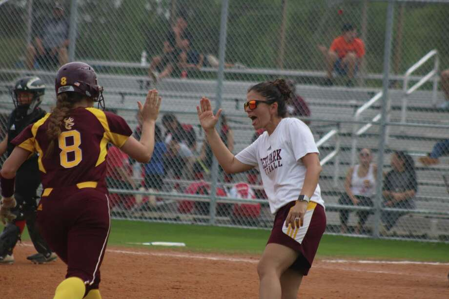 Deer Park head coach Errica Cantu celebrates the arrival of Jasie Roberts as she rounds third and heads for home after hitting an eighth-inning home run that enabled the Lady Deer to storm all the way back from a 3-0 deficit. Photo: Robert Avery