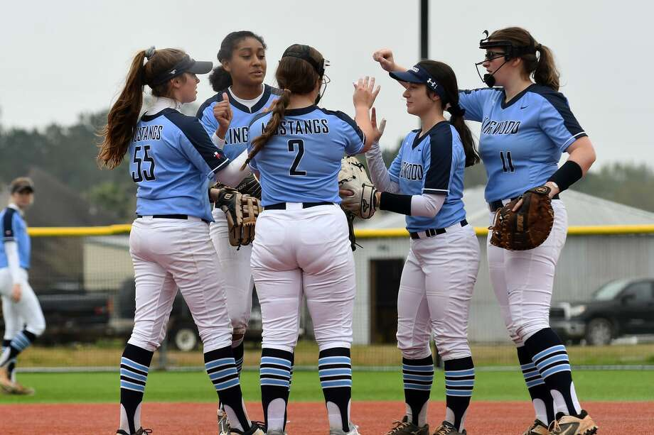Kingwood 3rd baseman Maddie Brewer, from left, shortstop Jourdyn Campbell, pitcher Mary Martinez, 2nd baseman Kat Martinez, and 1st baseman Bri Windham get pumped up before the start of an inning against Klein during their matchup at the Lone Star Cup High School Softball Tournament at the Scrap Yard Sports Complex in Conroe on March 2, 2019. Photo: Jerry Baker, Houston Chronicle / Contributor / Houston Chronicle