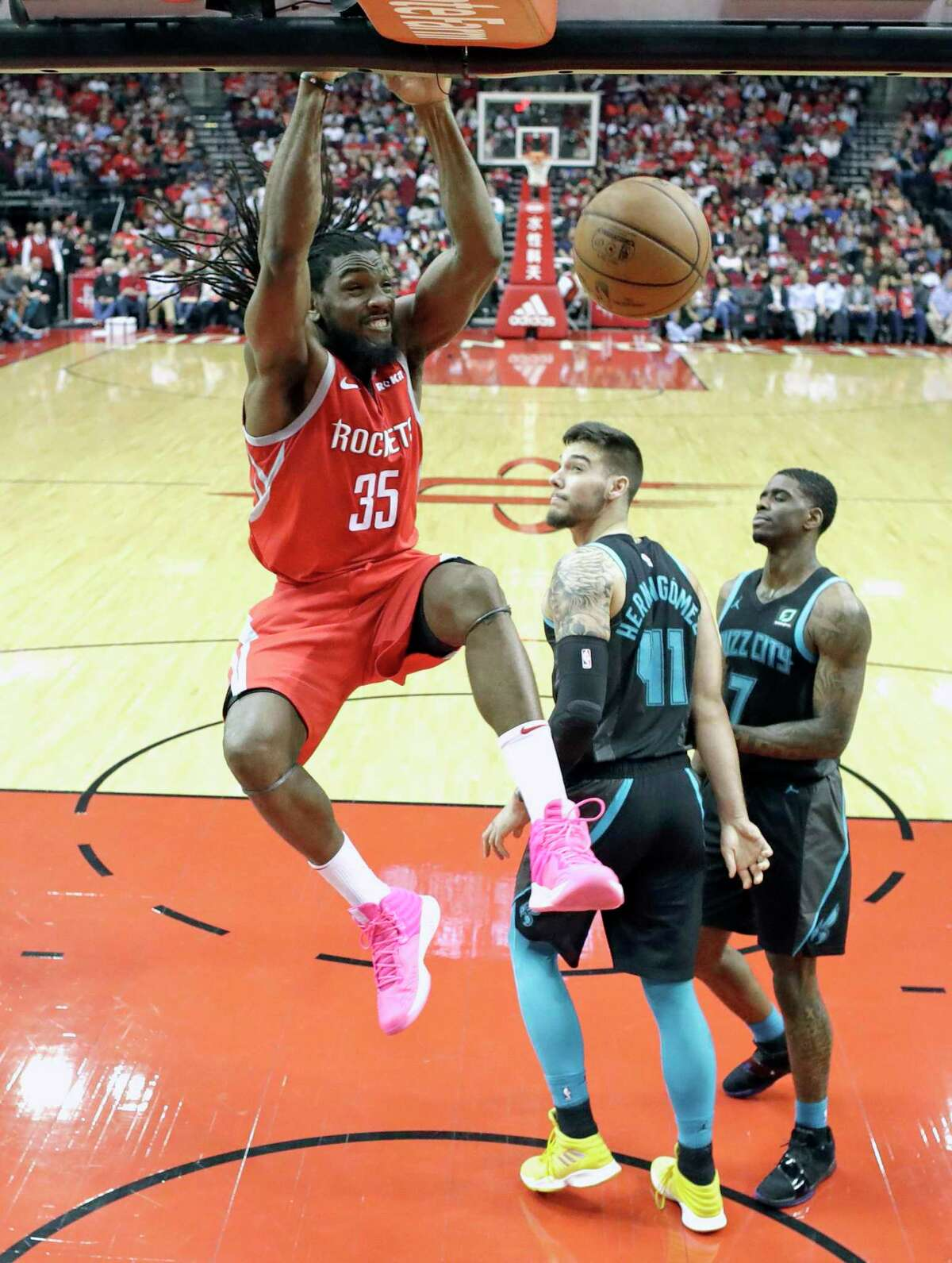 Houston Rockets' Kenneth Faried (35) dunks the ball as Charlotte Hornets' Willy Hernangomez (41) and Dwayne Bacon watch during the first half of an NBA basketball game Monday, March 11, 2019, in Houston. (AP Photo/David J. Phillip)