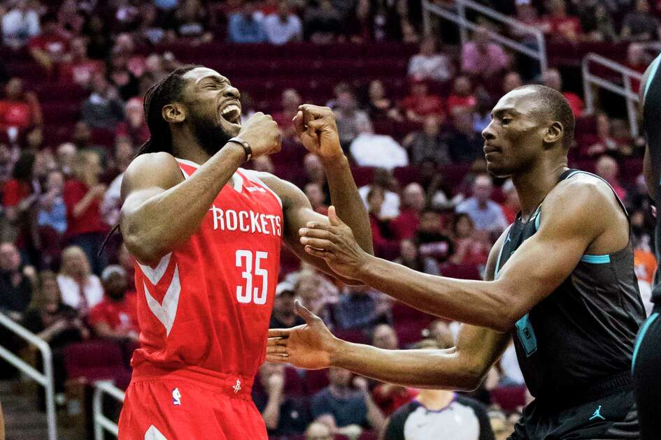 Houston Rockets forward Kenneth Faried, left, (35) reacts after scoring during the first half of the game against the Charlotte Hornets on Monday, March 11, 2019, in Houston.