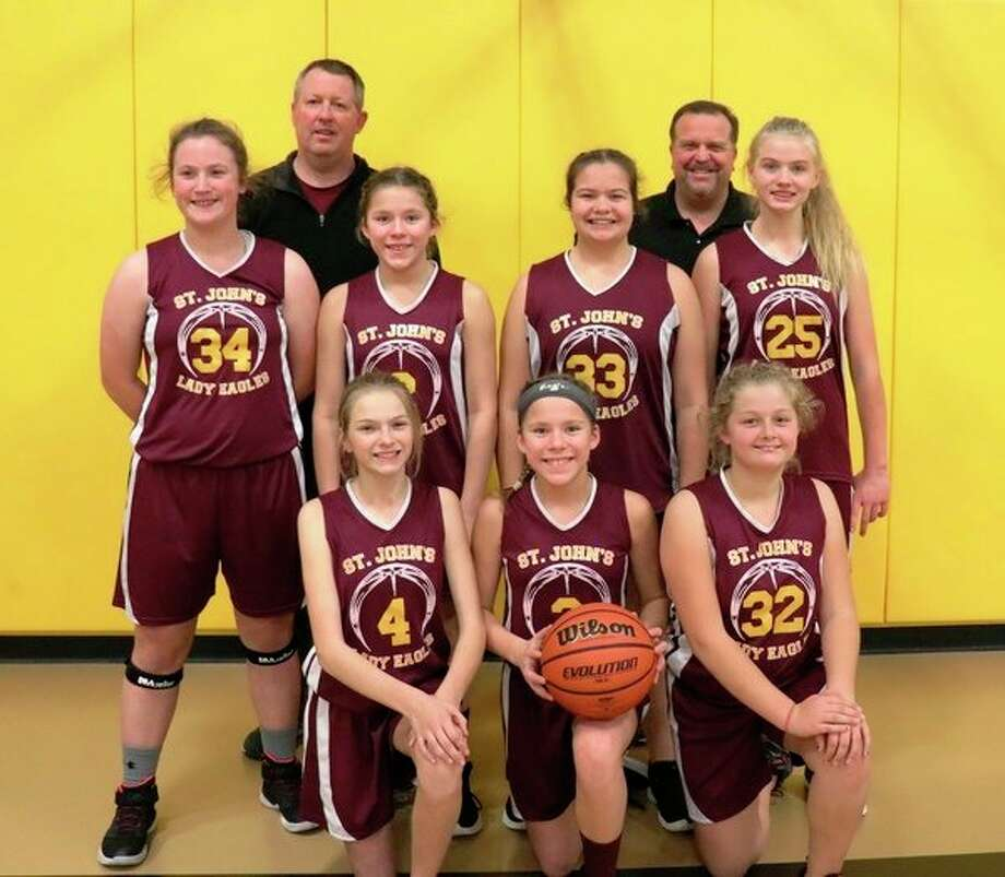 The St. John's Lutheran middle-school girls' basketball team included (front row, from left) Mackenzie Derusha, Claire Humburg, Laci Barth; (middle row, from left) Jenna Butcher, Lindsay Humburg, Kaitlyn Zastrow, Sofia Cain; (back row, from left) coaches Kage Butcher and Kris Zastrow. (Photo provided)