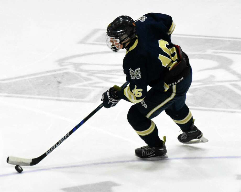 Newington co-op's Matt Lavoie skates with the puck in the Division III semifinals at Ingalls Rink on Monday. Photo: Pete Paguaga / Hearst Connecticut Media