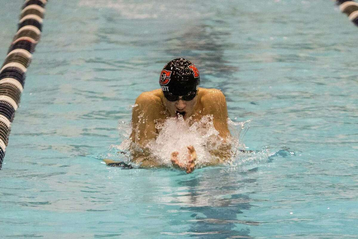 (John Vanacore/For Hearst Connecicut Media) New Canaan's Strider Bennett races the the breast stroke leg in the Class L state chmapionship 200 medley relay.
