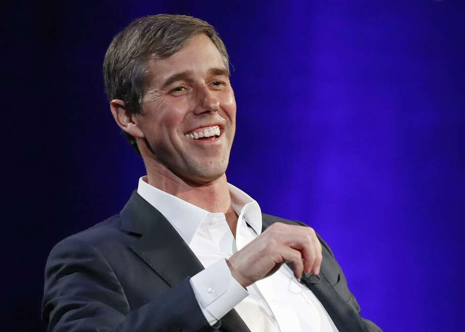 """FILE - In this Tuesday, Feb. 5, 2019 file photo, former Democratic Texas congressman Beto O'Rourke laughs during a live interview with Oprah Winfrey on a Times Square stage at """"SuperSoul Conversations,"""" in New York. The new Beto O'Rourke documentary, """"Running With Beto,"""" ends with him musing about how to keep the momentum of his 2018 defeat in the Texas Senate race going. O'Rourke himself attended the premiere Saturday, March 9, 2019, at South by Southwest, but he also was coy about his future, repeating only that he'll announce his plans """"soon."""" (AP Photo/Kathy Willens, File) Photo: Kathy Willens, STF / Associated Press / Copyright 2019 The Associated Press. All rights reserved."""