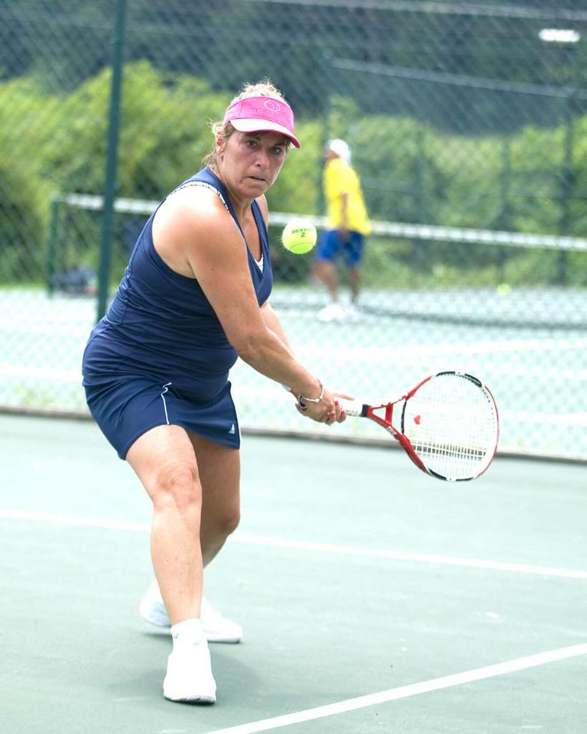 Sandra Atanasoff of Danbury hits a backhand return during her match against Cecily Koss of Southport in Danbury Open Tennis Tournament first round play Saturday at Wooster School in Danbury.